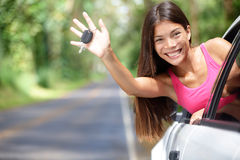 Car - woman showing new car keys happy. Car - woman showing new car keys smiling happy on road trip after getting drivers license. Beautiful young driving Royalty Free Stock Photos