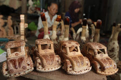 Car Wood craft. Worker making car craft made from wood in solo, central java, indonesia Stock Images