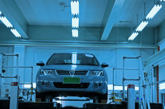 Car in workshop. For repair - blue tinted color Stock Photos