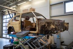 In car workshop the body of an old VW Golf