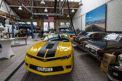 Car workshop for maintenance of classic American cars. BERLIN - MAY 13, 2017: Car workshop for maintenance of classic American cars. Center of competence for Stock Image