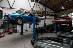 Car workshop for maintenance of classic American cars. BERLIN - MAY 13, 2017: Car workshop for maintenance of classic American cars. Center of competence for Royalty Free Stock Image