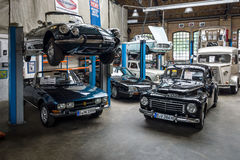 Car workshop for repair and maintenance of retro cars. BERLIN - MAY 13, 2017: Car workshop for repair and maintenance of retro cars. Center of competence for Stock Photos