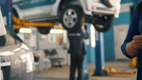 Car workshop - woman gives the keys of car for mechanic stock video