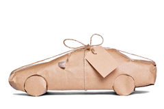 Car wrapped in brown paper cut out Stock Image