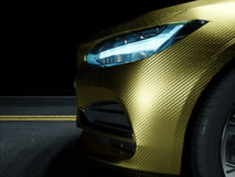 Car wrapped in golden carbon film Stock Photography