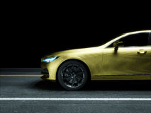 Car wrapped in golden carbon film Stock Photo