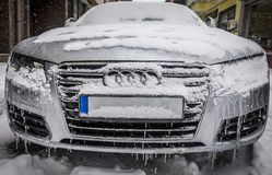 Frozen car all in ice and snow parked on a street in the city. Editorial use only. Burgas/Bulgaria/01.07.2017. Car wrapped in ice during the winter season Stock Photo