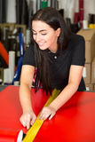 Car wrapping specialist cutting foils with box cutter. Car wrapping specialist cutting vinyl foils with box cutter Royalty Free Stock Photos