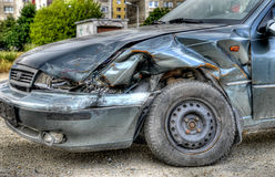 Car wreck. Wreck of abandoned car at parking place Royalty Free Stock Photography