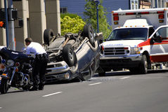 Car Wreck. With Rolled Car the Police and Ambulance Stock Images