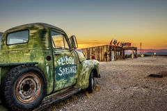Car Wreck And Rebuilt Cool Springs Station In The Mojave Desert Royalty Free Stock Images