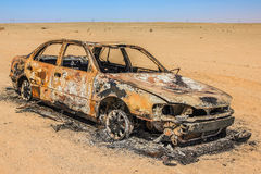 Car wreck burned. And abandoned in the desert of Namibia in Africa Royalty Free Stock Images