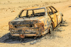 Abandoned burned car. Car wreck burned and abandoned in the desert of Namibia in Africa Royalty Free Stock Photography