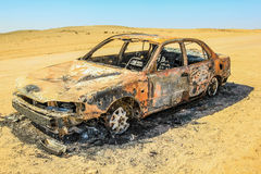 Car wreck. Burned and abandoned in the desert of Namibia in Africa Royalty Free Stock Images