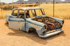 Car wreck on desert in Namibia Stock Images