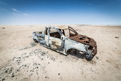 Car wreck in the desert royalty free stock image