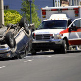 Car Wreck. With Rolled Car Police and Ambulance Stock Photos