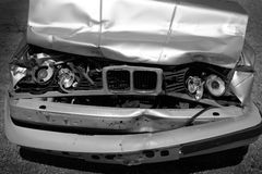 Car Wreck Smashed Hood and Grill with Headlights Stock Image