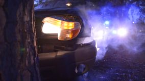 Car wreck into tree with police. Car wreck with smoke into tree with police stock video footage