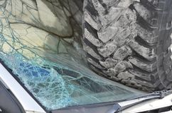 Car Wreck With Truck Tires on Windshield of Small Car Crash Dest Royalty Free Stock Photography