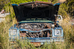 Car wreck. Used classic American car parked in the junkyard Stock Photography