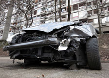 Wrecked car. On a parking lot, full frontal damage royalty free stock images