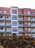 Car wreck yard with residential building in close proximity. Horizontal color image of car wreck yard with residential building in close proximity Stock Photos