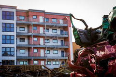 Car wreck yard with residential building in close proximity. Horizontal color image of car wreck yard with residential building in close proximity Stock Image