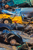 Car wrecks. Audi and diffrent smashed cars in the landfill Royalty Free Stock Photography