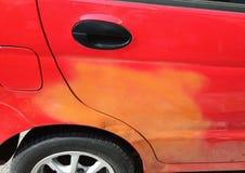A car with wrong color paintjob repair royalty free stock image