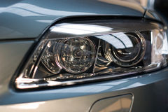 Car xenon lights close-up Royalty Free Stock Photo