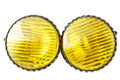 Car yellow fog lights. Car spare parts - yellow fog lights  on white background Stock Photos