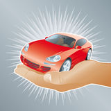 Car for you. Hand offering a red sport car Stock Image