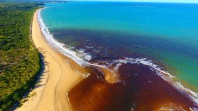 Caraíva, Bahia, Brazil: Aerial view of a beautiful beach with two colors of water. Fantastic landscape. Great beach view. Caraíva, Porto Seguro, Bahia royalty free stock photos