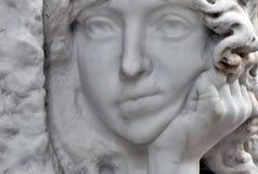 Cara aburrida de un ángel imagen de archivo libre de regalías