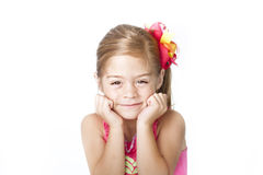 Cara adorable de la niña en el fondo blanco Foto de archivo libre de regalías