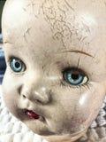 Cara antigua de la muñeca Foto de archivo