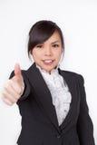 Cara asiática do sorriso da mulher com polegares acima fotografia de stock royalty free