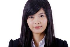 Cara asiática do sorriso da mulher no branco fotografia de stock