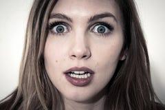 Cara asustada de mujeres Foto de archivo libre de regalías