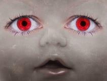 Cara asustadiza de la muñeca Foto de archivo libre de regalías