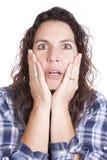 Cara azul de las manos de la expresión de la mujer Foto de archivo