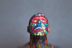 Cara colorida do super-herói que olha acima Foto de Stock