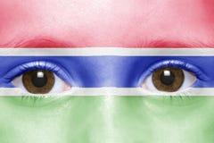 Cara com bandeira de gambia Imagens de Stock