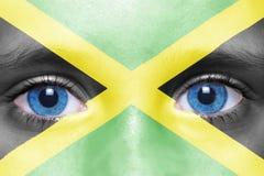 Cara com bandeira jamaicana Imagens de Stock