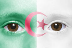 Cara con la bandera argelina Foto de archivo libre de regalías