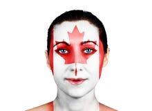Cara con la bandera canadiense Fotos de archivo libres de regalías