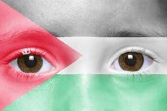 Cara con la bandera de Jordania Fotos de archivo