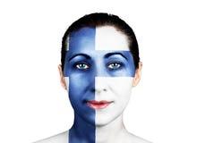 Cara con la bandera finlandesa Imagen de archivo libre de regalías